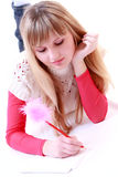 Girl write poetry. Beauty girl write poetry on white stock photography