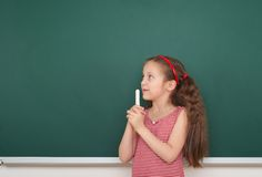 Girl write on the school board Stock Photo