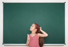 Girl write on the school board Royalty Free Stock Images