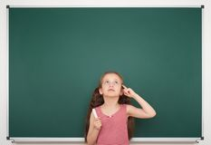 Girl write on the school board Stock Image