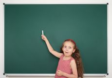 Girl write on the school board Royalty Free Stock Photo