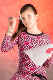Girl writes, composes a love letter. Stock Image