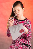 Girl writes, composes a love letter. Royalty Free Stock Photo