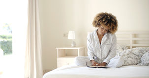 Girl Writes A Diary In Bed Stock Image