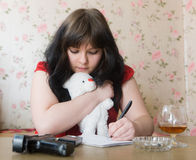 Girl writes a farewell letter Stock Photo