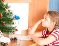 Girl writes a letter to Santa Claus Royalty Free Stock Photo