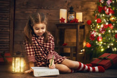 Girl writes the letter to Santa Royalty Free Stock Photo