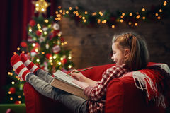 Girl writes the letter to Santa Stock Images