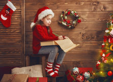 Girl writes the letter to Santa Royalty Free Stock Photography