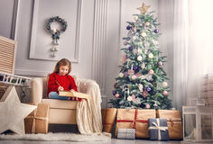 Girl writes the letter to Santa Stock Image