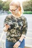 Girl writes message using mobile Royalty Free Stock Photos