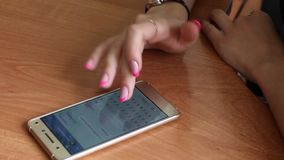 Girl writes the message in your phone. Close-up stock footage
