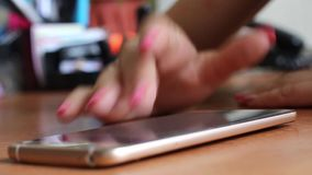 Girl writes the message in your phone. Close-up stock video