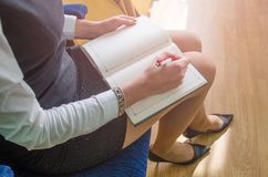 Girl writes in a notebook Royalty Free Stock Photo