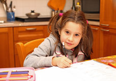 Girl writes on the notebook of schoolwork Stock Photos