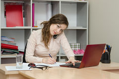 Girl writes on paper telephone conversation Royalty Free Stock Image
