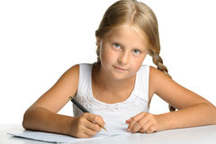 The girl writes to writing-book Royalty Free Stock Images