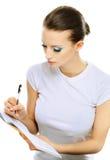 Girl writes to writing-books Royalty Free Stock Image