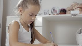 The girl writes to writing-books. The decision of lessons. work with tablet pc at home and doing homework stock footage