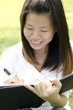Girl writing Royalty Free Stock Image