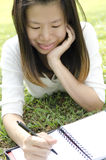 Girl writing Stock Photo