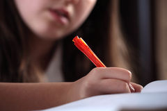 Girl writing Stock Images
