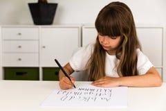 Girl writing the ABC alphabet Royalty Free Stock Photos