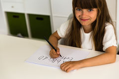 Girl writing the ABC alphabet Stock Photography