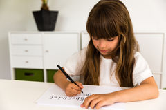 Girl writing the ABC alphabet Royalty Free Stock Photography