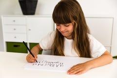 Girl writing the ABC alphabet Royalty Free Stock Image