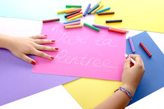 A girl writing back to school Stock Photo