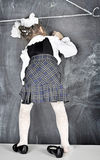 Girl writing on blackboard. Girl in school uniform writing on the blackboard Stock Images