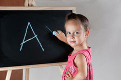 Girl writing Royalty Free Stock Image