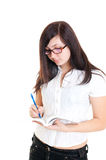 Girl writing in book Royalty Free Stock Photography