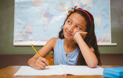 Girl writing book in classroom Royalty Free Stock Photography