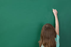 Girl Writing On Chalkboard Stock Images