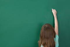 Girl Writing On Chalkboard Stock Images