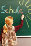 Girl writing on the chalkboard Royalty Free Stock Photo