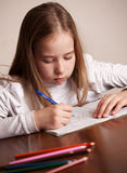 Girl writing Stock Photography