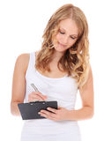 Girl writing on clipboard Royalty Free Stock Photography