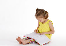 Girl writing drawing in notebook Royalty Free Stock Photography