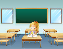 A girl writing with an empty board at the back Royalty Free Stock Images