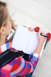 Girl writing in her diary Royalty Free Stock Photos