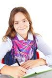Girl writing homework isolated over white Royalty Free Stock Photo