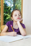 Girl writing homework notes Stock Photography