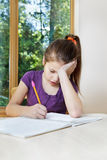 Girl writing homework notes Stock Images