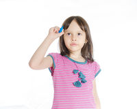 Girl writing on imaginary board. Asian girl with blue marker writing on imaginary board royalty free stock photography
