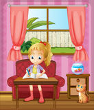 A girl writing inside the house with a cat Royalty Free Stock Images