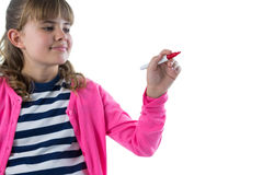 Girl writing on invisible screen. Against white background stock image