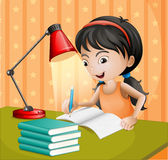 A girl writing with a lampshade Royalty Free Stock Photos